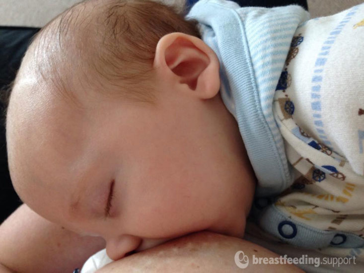 Baby breastfeeding to sleep