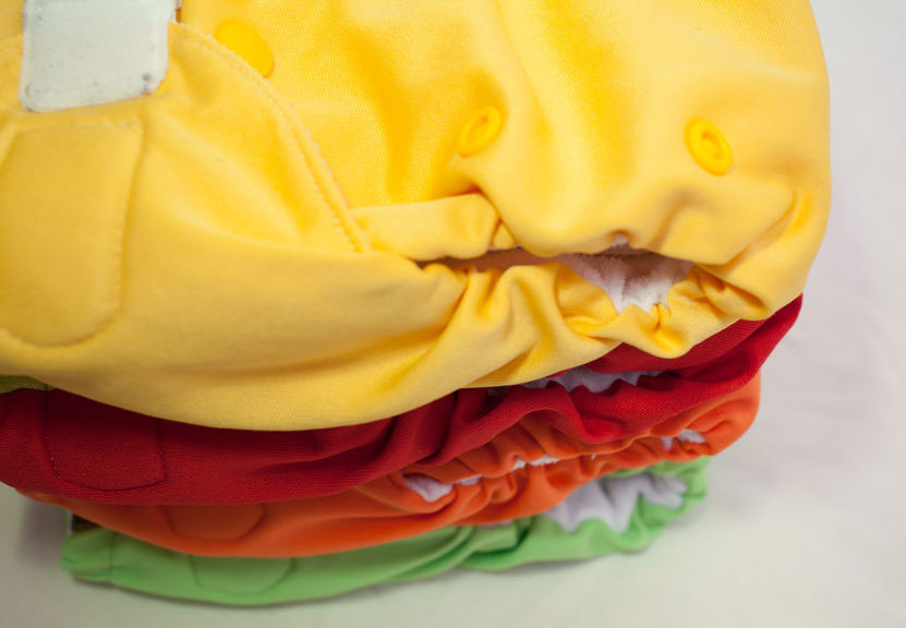 a pile of colourful washable nappies