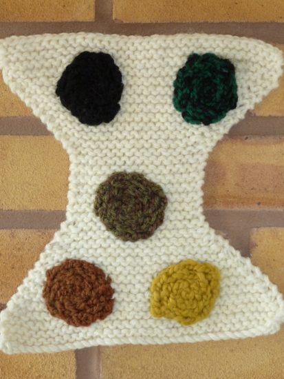 Knitted breastfed baby poop the first five days.