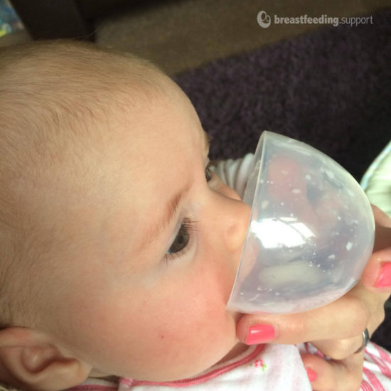 baby feeding from a cup