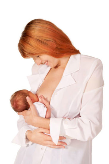 Cross cradle hold, standing up to breastfeed