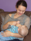 baby breastfeeds in a cradle hold