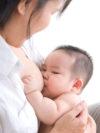 Asian baby breastfeeding