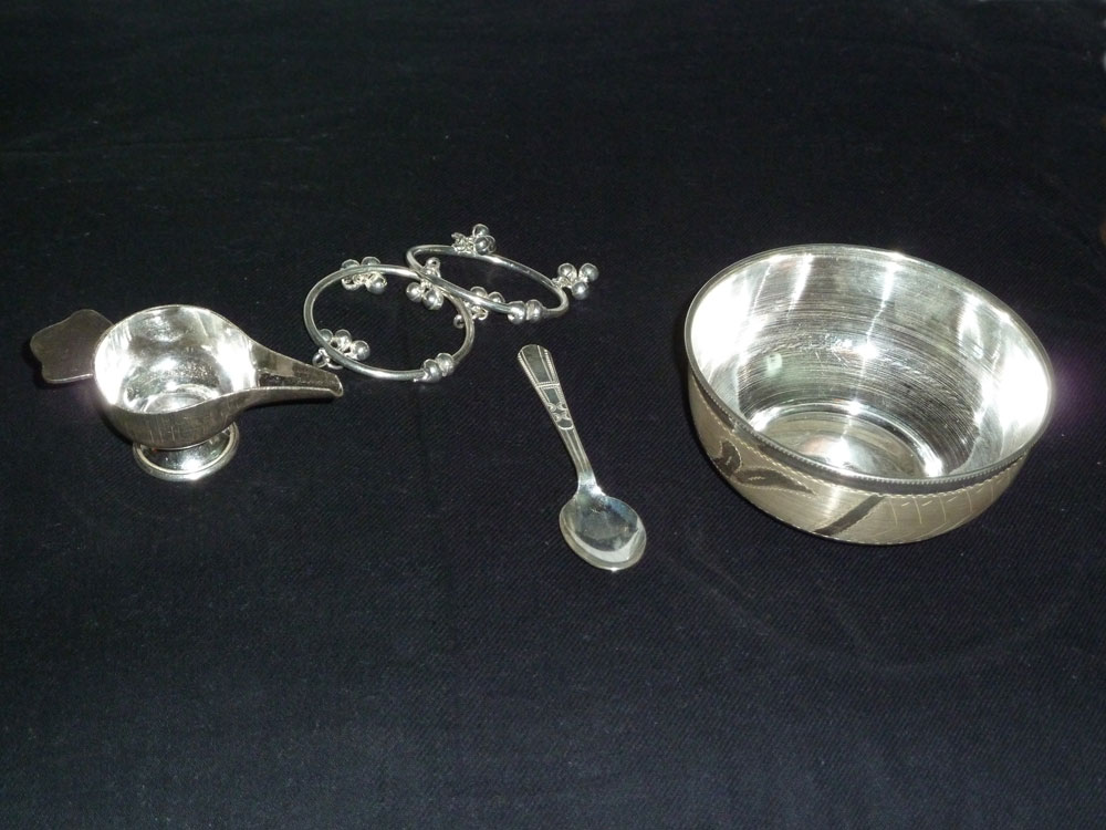 silver plated paled as part of a baby gift set